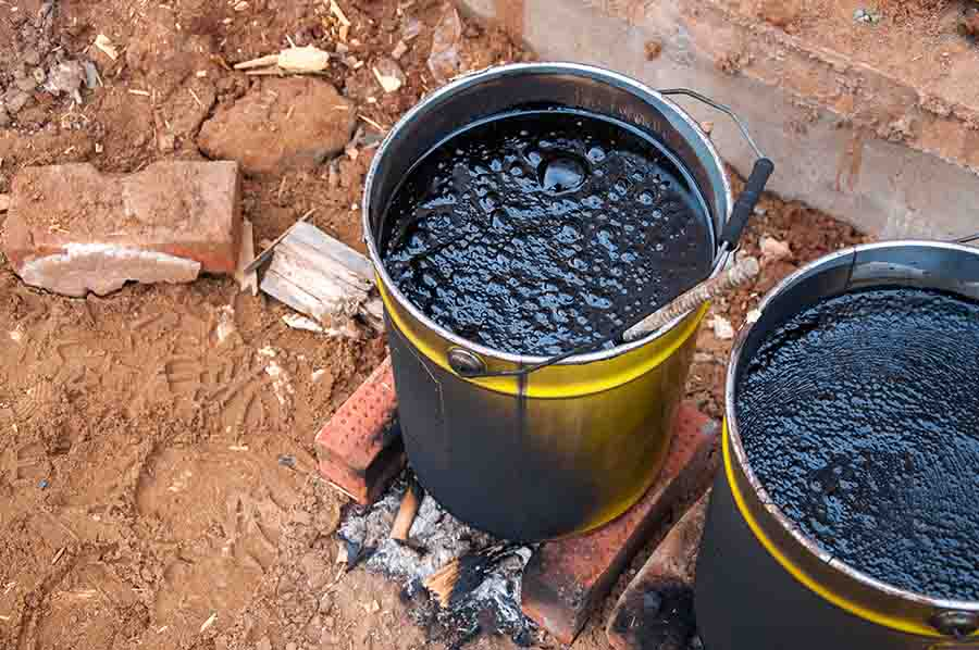bitumen liquid being prepared for roof torch on application