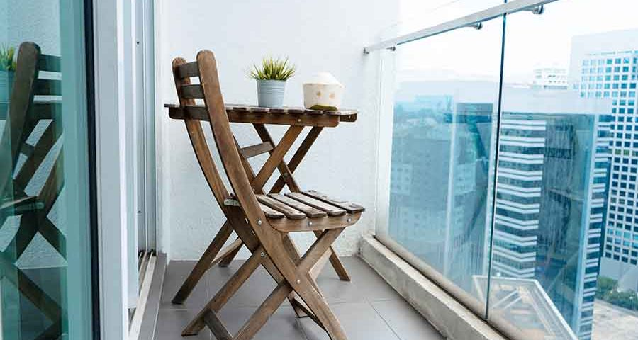 two chairs on apartment balcony facing outside